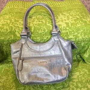 small grey purse with 2 straps.